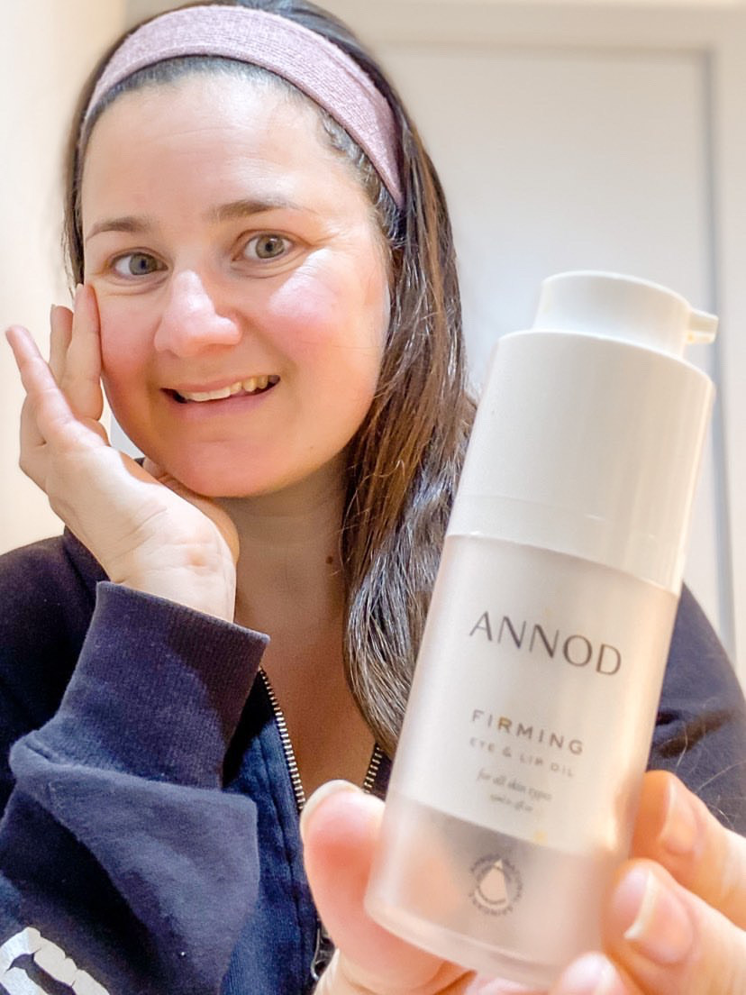 A customer with Annod's Firming Eye and Lip Oil