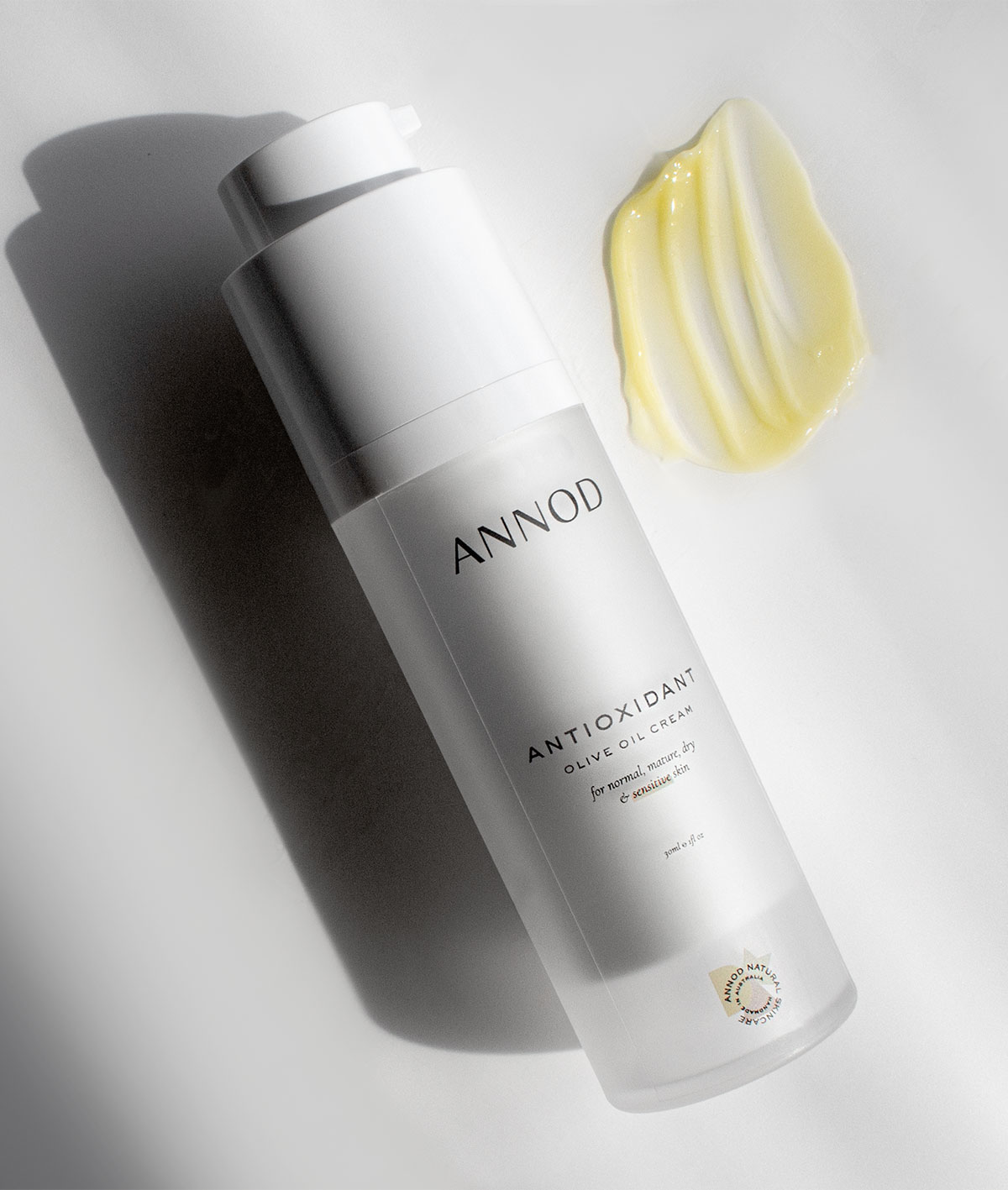 Texture and a bottle of Antioxidant Olive Oil cream, 30ml